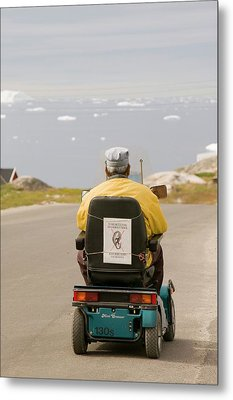 An Inuit Man In A Mobility Scooter Metal Print by Ashley Cooper