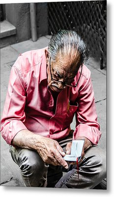 An Old Man Reading His Book Metal Print by Sotiris Filippou