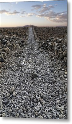 Ancient Rocky Road Leading To The Horizon. Metal Print by Edward Fielding