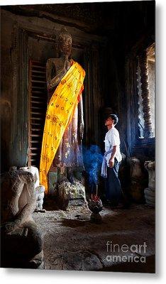 Angkor Wat Devotee Lights Incense In Buddha Temple Metal Print