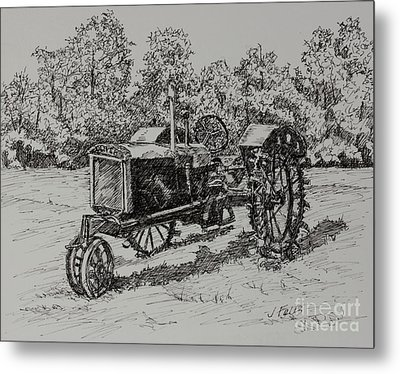 Antigue Tractor Metal Print by Janet Felts