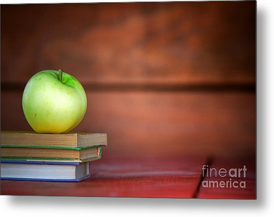 Apple On Pile Of Books Metal Print by Michal Bednarek