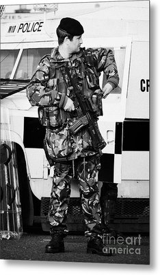 Armed British Soldier At Psni Landrover On Crumlin Road At Ardoyne Shops Belfast 12th July Metal Print by Joe Fox