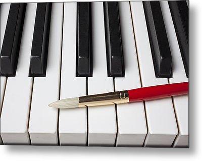 Artist Brush On Piano Keys Metal Print by Garry Gay