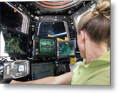 Astronaut In Iss Robotics Workstation Metal Print by Nasa