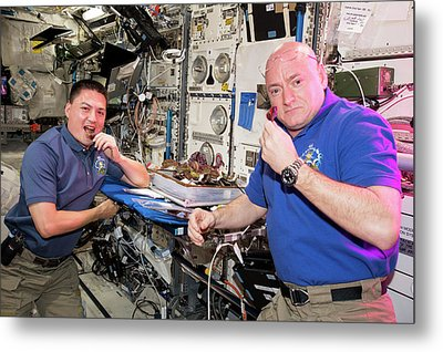Astronauts Eating Food Grown In Space Metal Print by Nasa