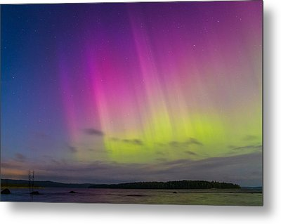 Auroras Over A Lake Metal Print by Janne Mankinen
