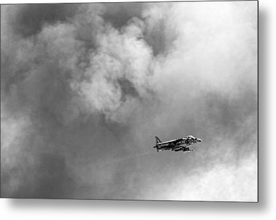 Av-8b Harrier Flies Through The Smoke Of War Metal Print by Peter Tellone
