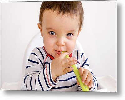 Baby Boy Playing With A Spoon Metal Print