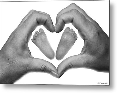 Baby Feet In Mothers Hand Metal Print by Jay Harrison
