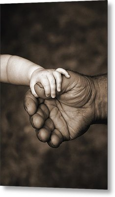 Babys Hand Holding On To Adult Hand Metal Print by Corey Hochachka