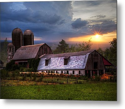 Barns At Sunset Metal Print by Debra and Dave Vanderlaan
