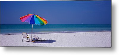 Beach Umbrella And A Folding Chair Metal Print by Panoramic Images