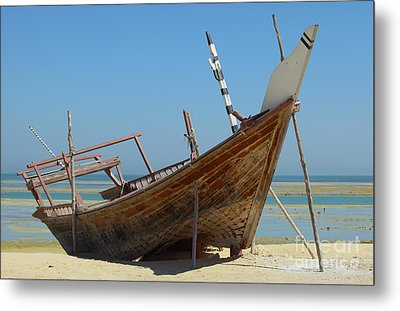 Beached Dhow At Wakrah Metal Print by Paul Cowan