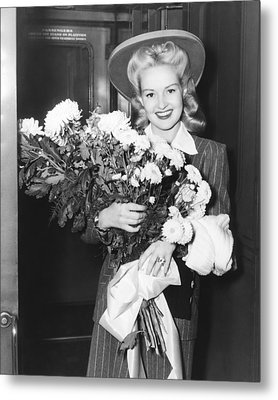 Betty Grable With Flowers Metal Print