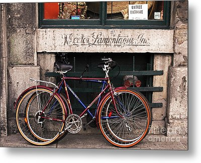 Bikes In Old Montreal Metal Print by John Rizzuto