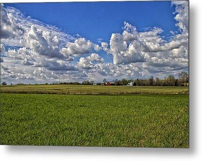 Billow Skies On Green Metal Print by Bill Tiepelman