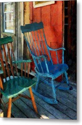 Blue Chair Against Red Door Metal Print by Susan Savad