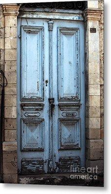 Blue Door In Limassol Metal Print by John Rizzuto