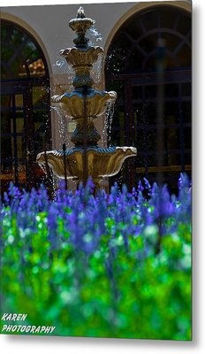 Blue Flowers And A Fountain Metal Print