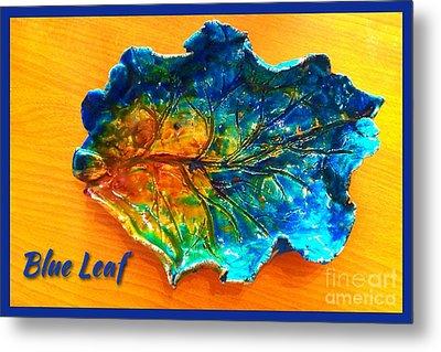 Blue Leaf Ceramic Design Metal Print by Joan-Violet Stretch