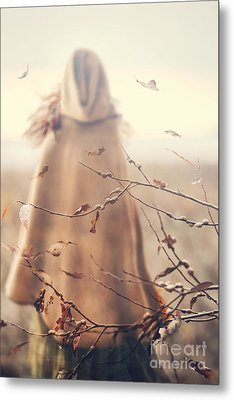 Metal Print featuring the photograph Blurred Image Of A Woman With Cape by Sandra Cunningham
