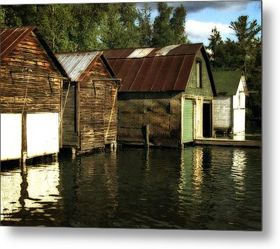 Boathouses On The River Metal Print by Michelle Calkins