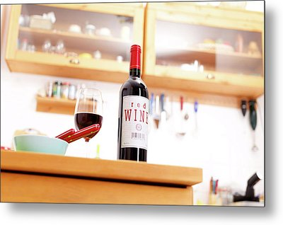 Bottle Of Red Wine On A Kitchen Table Metal Print by Wladimir Bulgar