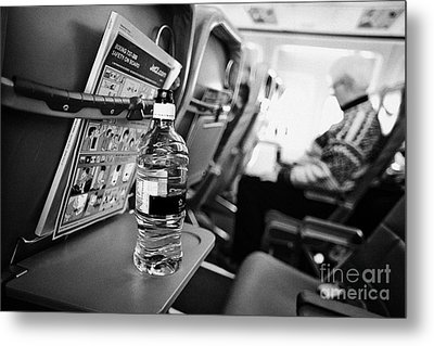 Bottle Of Water On Tray Table Interior Of Jet2 Aircraft Passenger Cabin In Flight Metal Print by Joe Fox