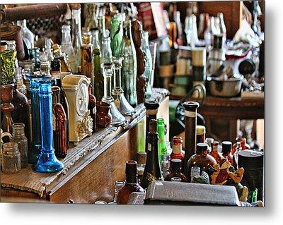 Bottles In The Old Stuff Shop Metal Print by Lynn Jordan