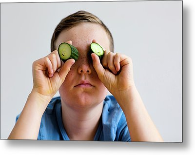 Boy Holding Cucumber Over Eyes Metal Print by Gombert, Sigrid