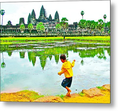 Boy Playing By The Moat In Angkor Wat In Angkor Wat Archeological Park Near Siem Reap-cambodia Metal Print by Ruth Hager