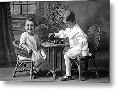 Boy Pours Sister A Cup Of Tea Metal Print by Underwood Archives