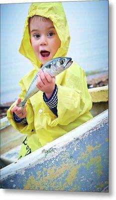 Boy Wearing Raincoat Holding A Mackerel Metal Print by Ruth Jenkinson