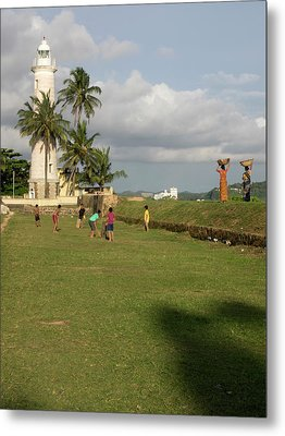 Boys Playing Cricket, Galle Lighthouse Metal Print by Panoramic Images