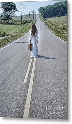 Bride Walking With Suitcase On Country Road Metal Print by Jill Battaglia