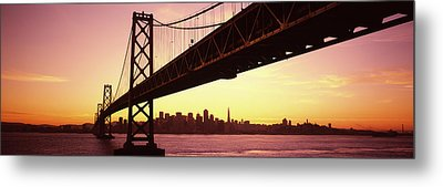 Bridge Across A Bay With City Skyline Metal Print by Panoramic Images