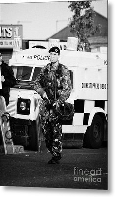 British Army Soldier At Psni Landrover On Crumlin Road At Ardoyne Shops Belfast 12th July Metal Print by Joe Fox