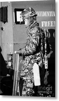 British Army Soldier In Riot Gear With Fire Extinguisher In Front Of Land Rover On Crumlin Road At A Metal Print