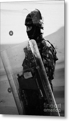 British Army Soldier With Helmet And Shield Riot Gear On Crumlin Road At Ardoyne Shops Belfast 12th  Metal Print by Joe Fox