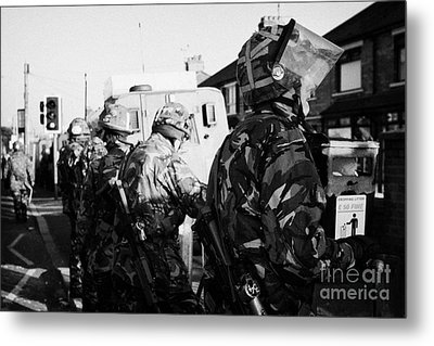 British Army Soldiers In Riot Gear Stand Guard On Crumlin Road At Ardoyne Shops Belfast 12th July Metal Print by Joe Fox