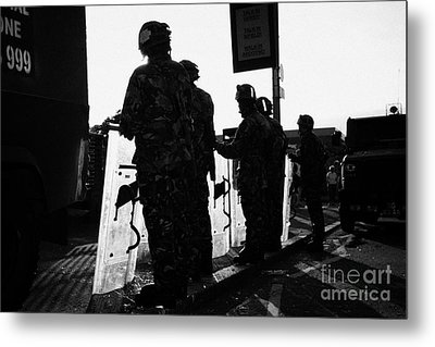 British Army Soldiers In Riot Gear With Shields Backlit Silhouette Beneath Protest Sign On Crumlin R Metal Print