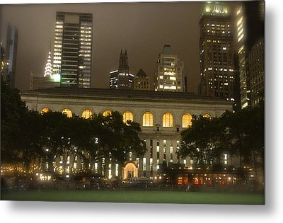 Bryant Park In New York City At Night Metal Print by Michael Dagostino