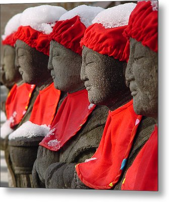 Buddhist Statues In Snow Metal Print by Larry Knipfing