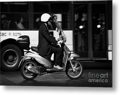 Business Man In Suit And White Helmet On Scooter Commutes Past Bus Full Of Passengers Through Piazza Metal Print by Joe Fox