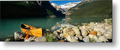 Canoe At The Lakeside, Lake Louise Metal Print by Panoramic Images