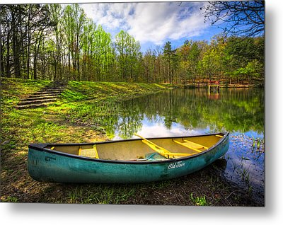 Canoeing At The Lake Metal Print by Debra and Dave Vanderlaan