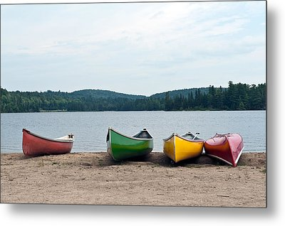 Canoes On The Lake Metal Print by Marek Poplawski