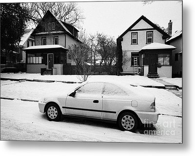 car covered in snow parked by the side of the street in front of residential homes caswell hill Sask Metal Print by Joe Fox
