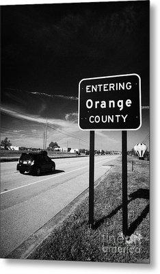 Car Entering Orange County On The Us 192 Highway Near Orlando Florida Usa Metal Print by Joe Fox